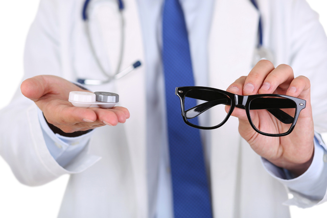 Male Doctor Hands Giving Pair Of Black Glasses