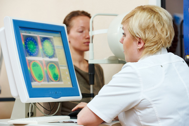Optometry concept. female optometrist optician doctor evaluates